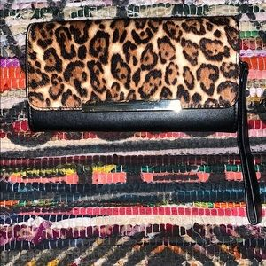Cheetah and leather clutch 👝 with gold accents